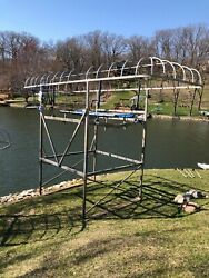 Boat Lift With Electric Motor And Black Canopy