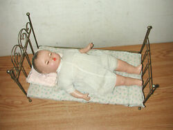 Antique Baby Doll Lying In Metal Wire Bed With Mattress, Pillow And Cover