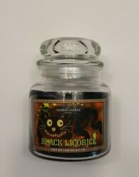 Retired Yankee Candle 14.5 oz Black Licorice Glowing Chesire Cat Grin Label