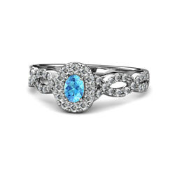 Oval Cut Blue Topaz And Diamond Halo Engagement Ring 0.75 Ctw 14k Gold Jp156875