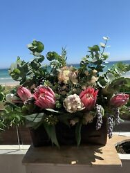 Artificial Native Floral Prote Arrangement In A Vintage Leather Tool Box