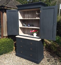 Antique Linen Press In Farrowandball Andlsquooff Blackandrsquo With A Lime Washed Interior.