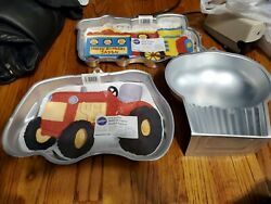Wilton Train And Tractor Cake Pan With Instructions As Well As Muffin Pan.