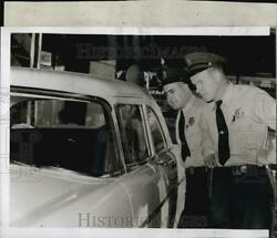 1955 Press Photo Officers Michael Cammarata And Daniel Donahue With Abandoned Car