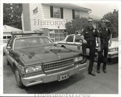 1991 Press Photo Police Officers Robert And Michael Mull With Patrol Cars