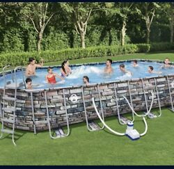 Coleman 26x12x52in Power Steel Oval Above Ground Pool W/ Wifi Pump In Hand
