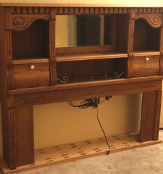 Vintage Oakwood Interiors Queen Headboard With Lighted Bookshelf And Storage.