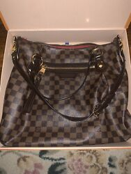 louis vuittons handbags authentic used $850.00