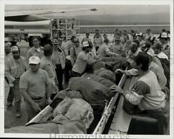 1989 Press Photo Forest Fire Firefighters At Airport Luggage Conveyor Belt
