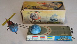 1957 tin wind up remote helicopter hans