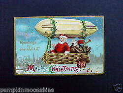 H482- Unused 1900 Xmas Greeting Postcard Santa Riding Blimp With Gold Accents