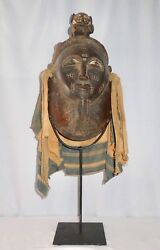 Carved Wooden African Baoulandeacute Mask Made In Gabon. Wood + Fabric. Includes Stand.