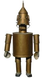 A Large Gold One-of-a-kind Robot Made From Various Materials. Not Like Most Seen