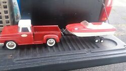 Vintage Red Tonka Pickup Truck With Boat And Trailer.