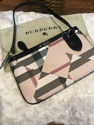 Burberry Wristlet With Patent Leather Trim $145.00