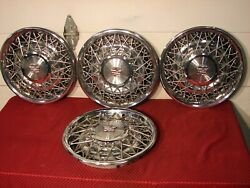 75-85 Cadillac Fleetwood Deville Wire Hubcaps.......nice