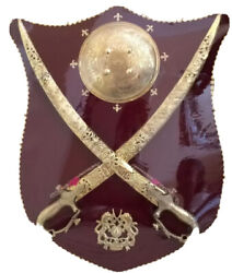 A Newly Made Wall Decorative Set Of Two Short Swords Small Shield And Rajput Logo