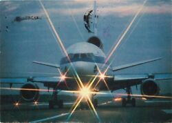 Postcard Dc-10 Jet Airplane Taxying On Runway W/ Lights