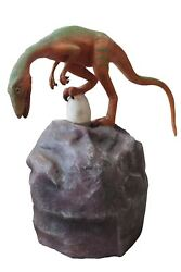 Orange And Green Compsognathus Dinosaur With Egg On Rock Life Size Statue