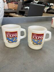 Pair Of Vintage 1982 Fire King Certified Grocers Expo Milk Glass Coffee Mugs