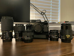 Minolta X-700 W/ Motor Drive 3 Prime Lenses And 2 Zoom Lenses With Manual