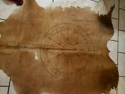 Genuine Brown And White Cow Hide Rug With Branded Mandala Design