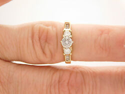 0.75 Carat T.w. Round And Baguette Cut Diamond Engagement Ring 14k Yellow 27422