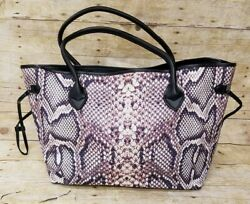 Snake skin tote. 20x12. New. Magnetic closure one zipper pocket on the inside $22.00