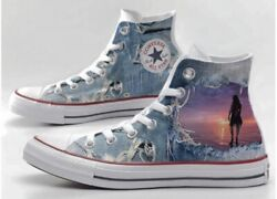 converse all star printed with jeans and woman with sunset