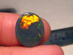 6.1 Ct  Large Natural Australian Black Opal Puzzle Pattern Red Color