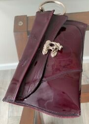 H OM E Lacquered Leather Clutch. Wine Color. $80.00