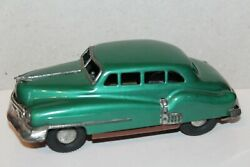 Very Nice Vintage Tin Friction Powered Fat Bodied 1950's Oldsmobile Sedan