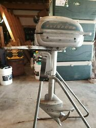 Vintage Evinrude Outboard Motor And Stand