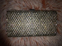 Silver clutch purse with strap. $20.00