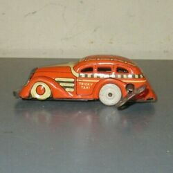 Vintage 30's/40's Marx Tin Litho Wind Up Orange And White Tricky Taxi Works