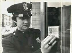 1976 Press Photo Police Officer Thomas Smith With Operation Prevention Sticker