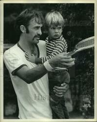 1972 Press Photo Professional Tennis Player John Newcombe Holds Son Clint.