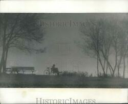 1977 Press Photo Bicyclist Sitting In Fog Atop A Bluff Near South Shore Park