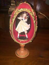 Dancing Girl Holding A Nutcracker Inside Of A Stand Up Faberge Egg