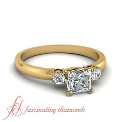 3/4 Carat Three Stone Engagement Ring In Yellow Gold With Princess Cut Diamond
