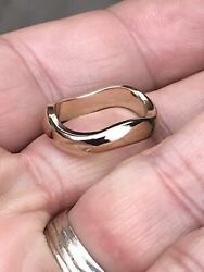 A Love Me 18ct Gold Band Ring Designed Aa An Undulating Band Signed