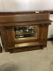 Antique American Oak Overmantel With Beveled Mirror And Carved Features 1900-1920