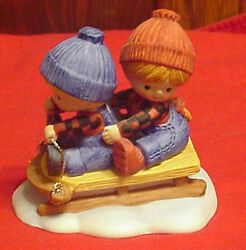 Enesco Country Cousins Katie And Scooter Sledding