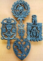 4 Vintage Cast Iron Trivets W/brooms , Birds, Eagle And Other Designs