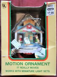Vintage Eluceo In Motion Musical Christmas Ornament Santa's Toy Shop