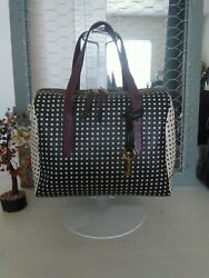 Fossil Sydney brown and white polka dots no strap $25.00