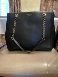 Black Leather Kate Spade Handbag With Gold Hardware And Chain Straps