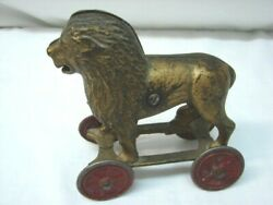 Antique Cast Iron Lion Bank On Red Wheels