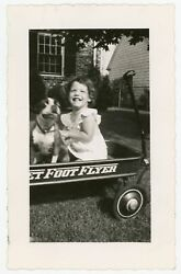 HAPPY GIRL AND BOSTON TERRIER DOG IN RED WAGON VINTAGE SNAPSHOT PHOTO