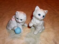 A PAIR OF PLAYFUL PORCELAIN BISQUE FLUFFY KITTENS MARKED 1410 + CROSSED ARROWS